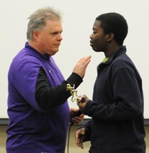 Eighth grade head football coach John Sappington congratulates Cameron Jenkins for receiving the Tough Man Award.