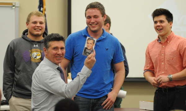 Keith Herring receives a gag gift of hair coloring from senior football players (from left) Tyler Pryor-Hall, Kyle Pudlowski, Reid Nelson and Jim Smith.