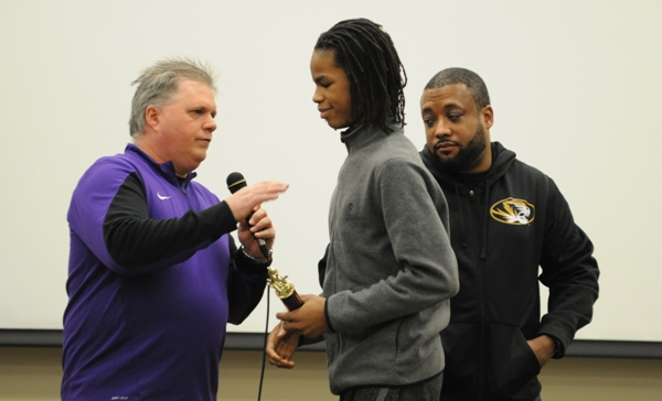 Eighth-grader Jordan Tate receives the Team MVP Award from coaches John Sappington (left) and Fred Brown.
