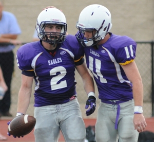 Jacob Clay (left) and Kyle Pudlowski celebrate a Clay touchdown at the preseason football jamboree at Windsor High School last August. Last week Clay was named the team's offensive MVP and Pudlowski the defensive MVP.