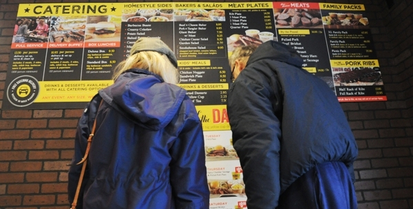 Two customers study the menu at Dickey's Barbecue Pit today at around noon. (Photos by Steve Bowman)