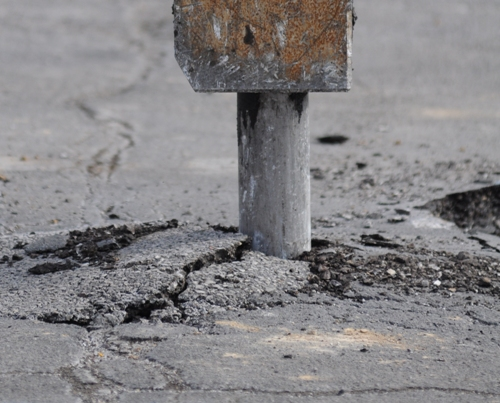 . . . and pounds through the asphalt.
