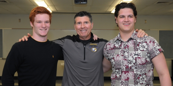 Kyle Pudlowski (left) and Alex Patton (right) pose for a photo with Brentwood High School football coach Keith Herring at a party celebrate their signing letters of intent to play football at Lindenwood University in Bellevile, Ill. (All photos by Steve Bowman)