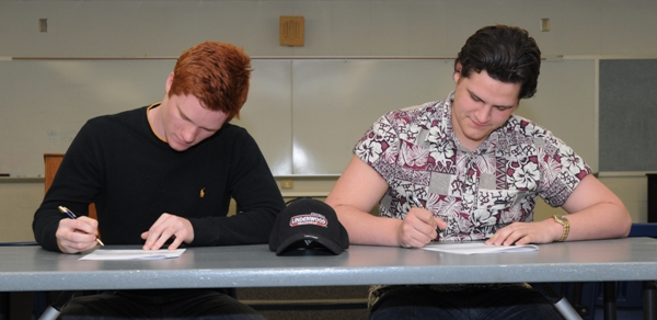 Kyle Pudlowski (left) and Alex Patton sign ceremonial letters of intent. They actually signed letters earlier - Pudlowski last month and Patton this month.