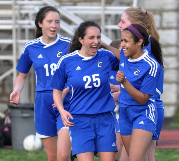 Crossroads players celebrate moments after the end of their 1-0 victory over Brentwood.