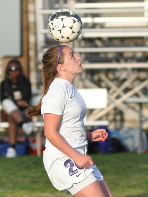 Abby Harper steadies a slow-bouncing ball in the second half of the Crossroads game.