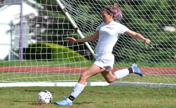 Aileen Frazier kicks the ball into play from near her goal.