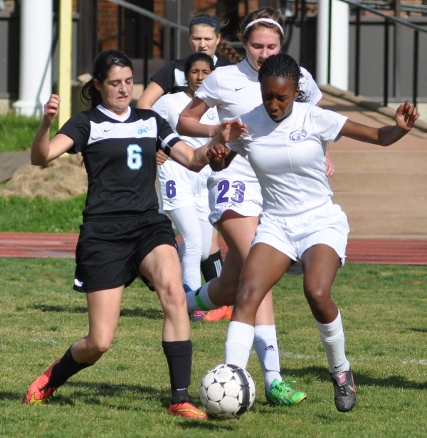 Cierra Lucas (right) tries to win the ball from Jill Smith of O'Fallon Christian.