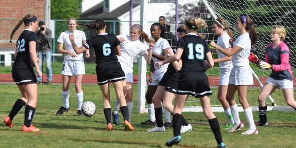 Julianna Nikodym and Cierra Lucas try to clear the ball from in front of the goal.