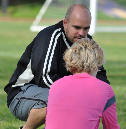 Assistant coach Brian Wildgrube encourages Audrey Brown at halftime.