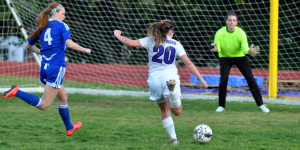 Abby Harper closes in on Crossroads goalkeeper Kieran in the second half.  The Eagles came close to tying the score several times in the final 10 minutes.