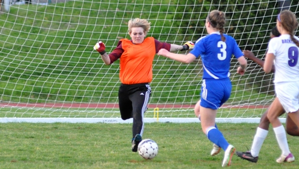 Brentwood goalkeeper Audrey Brown intercepts a ball before Jill Smith of Crossroads can take a shot in the second half.
