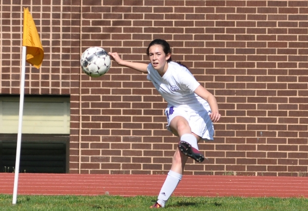 Amanda Ingersoll kicks across to teammates in front of the Christian goal.