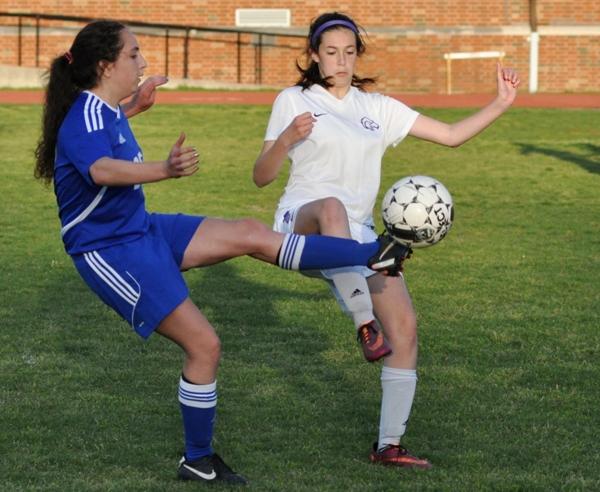 Amanda Ingersoll fights for possession.