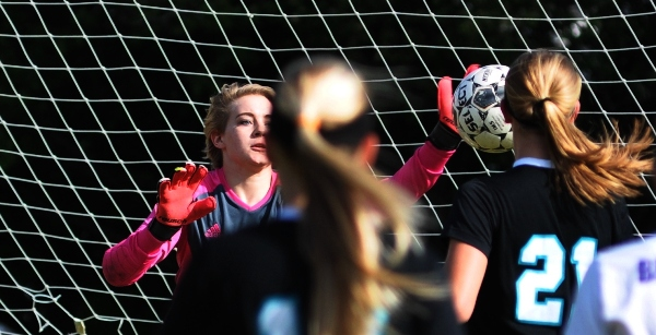 Brentwood goalkeeper Audrey Brown stops a shot from Christian O'Fallon in the first half on Monday. The 9-2 Knights gave the Eagles all they could handle, winning 9-0. (All photos by Steve Bowman)