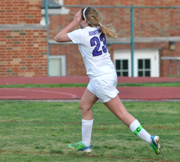 Tara Lochmoeller covers her face after nearly scoring with six minutes left against Crossroads.