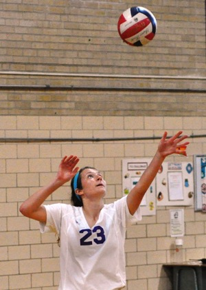 Sophomore Tara Lochmoeller serves the volleyball in a 2013 game.