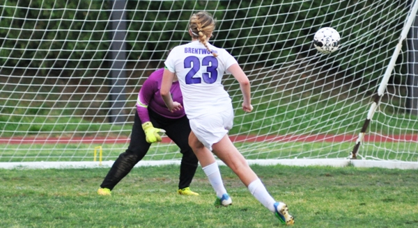 Tara Lochmoeller gets one-on-one at close range with Valley Park goalkeeper Jill Smith and pops the ball into the right side of the net to make it 4-0.