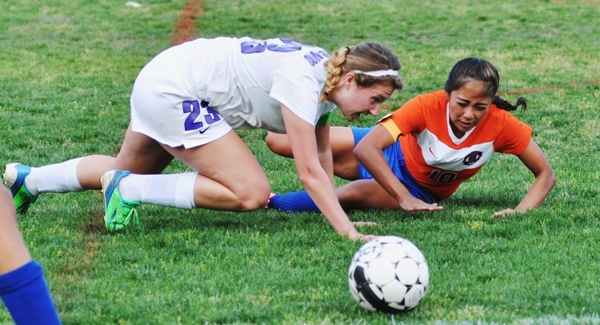 Tara Lochmoeller gets back up after falling with a Valley Park player.