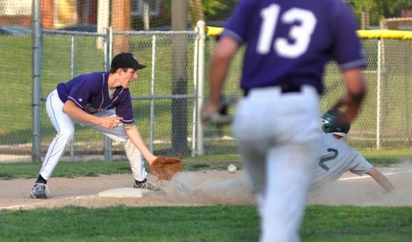 Seth Winkleman receives a throw at third base.