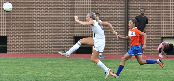 Kate Gilmore follows her kick toward the Valley Park net.