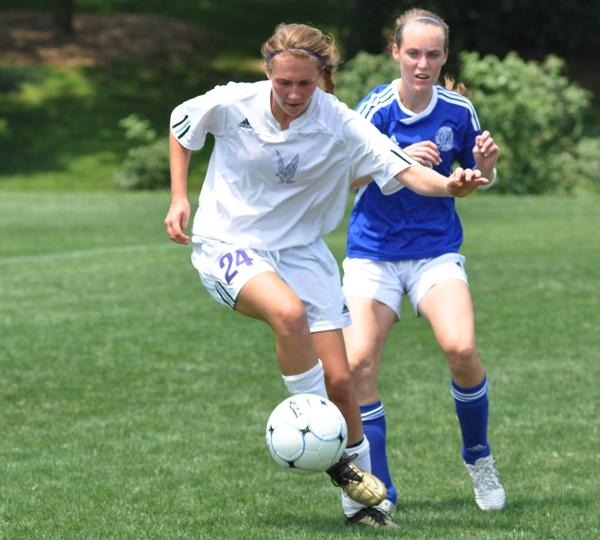 Freshman Tara Lochmoeller drives the ball in the district title game with John Burroughs in 2012.