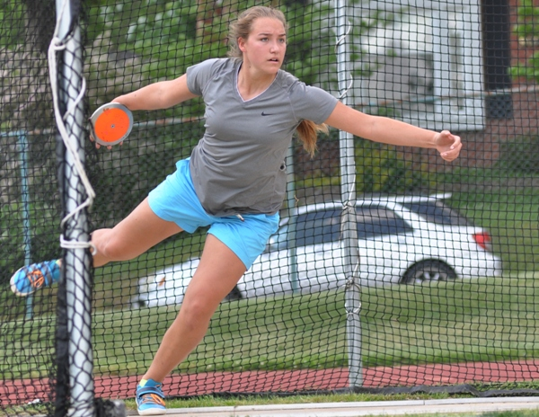 Sophia Rivera winds up to throw the discus in practice. On Friday and Saturday she will attempt to win her fifth and sixth state gold medals in the discus and shot put.