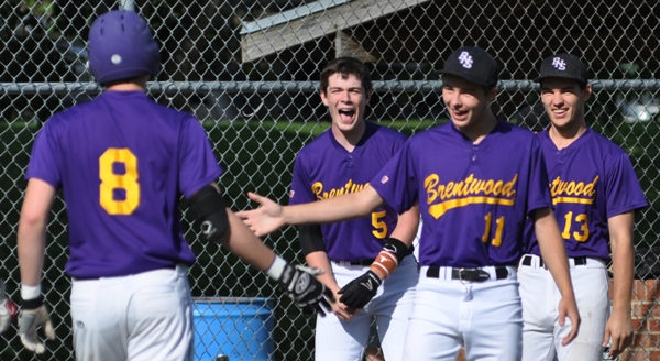 Skylar Sappington (left) is greeted by teammates (from left) Stephen Suntrup, Bradley Jones and Jim Smith after hitting a three-run home run in the third inning to put Brentwood ahead of Valley Park on Wednesday at Brentwood Park. (All photos by Steve Bowman)