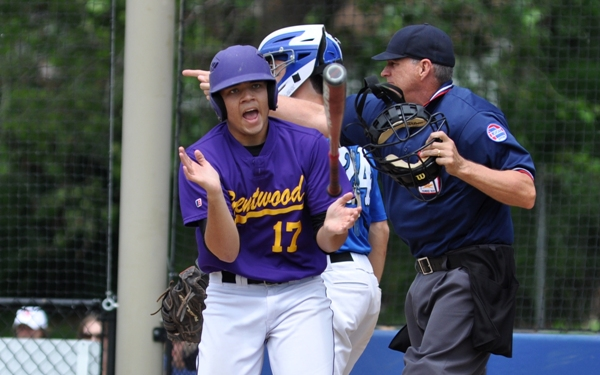 Mike Mills claps after being hit by a pitch to load the bases in the seventh inning.