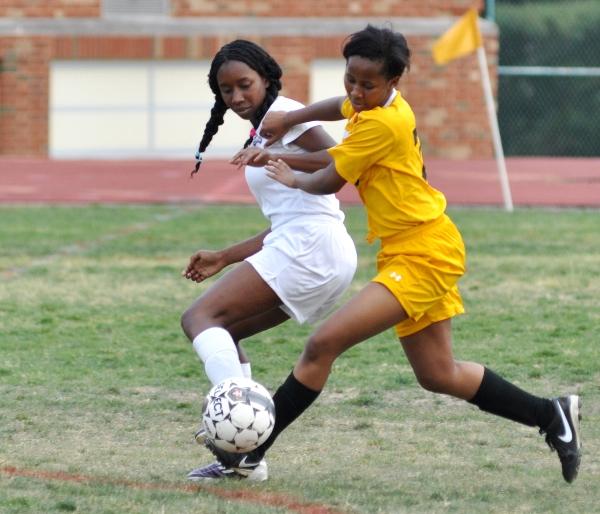 Cierra Lucas (left) scraps with a University City player.