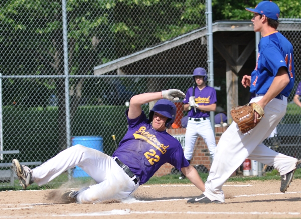 John Bischoff slides safely into home plate in the first inning, scoring Brentwood's first run.