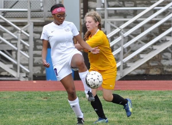 Oni Wright makes contact with the ball.