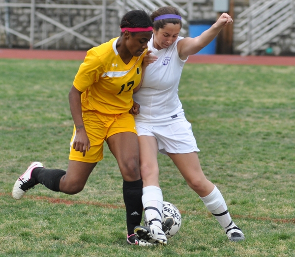 Madeline Neely fights for the ball.