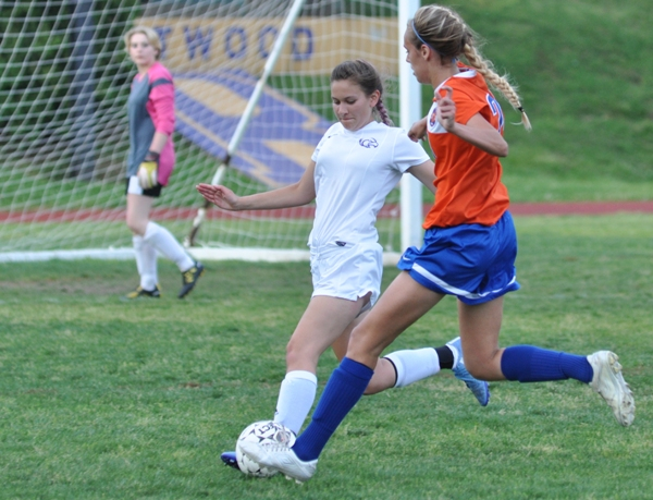 Aileen Frazier heads off a Valley Park attack in the first half as goalkeeper Audrey Brown watches.