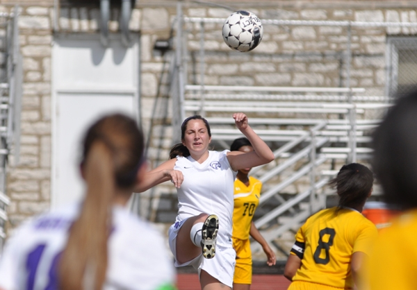 Madeline Neely gets the ball away from Brentwood's goal.