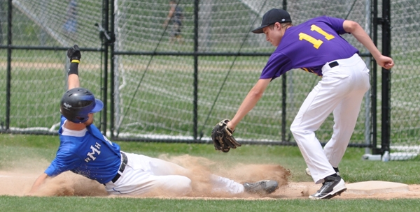 Bradley Jones reaches to tag Dan Williams as he slides into first base.