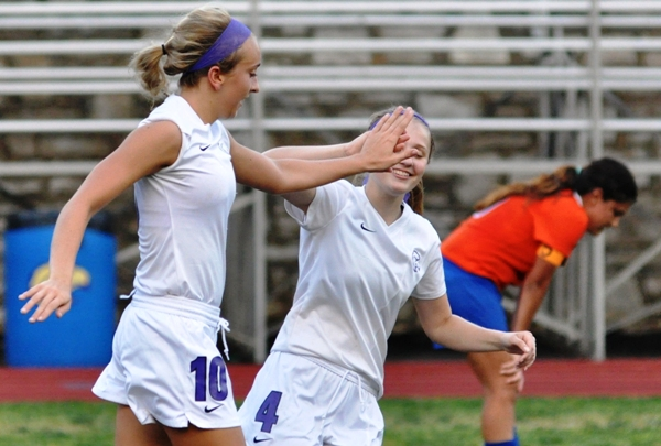 Kate Gilmore (left) gets a hand slap from Julianna Nikodym after scoring to make it 3-0 against Valley Park.