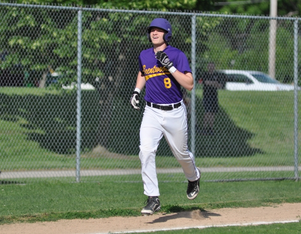 After rounding third base, a smiling Skylar Sappington heads home to make the score 4-3 in the third inning.