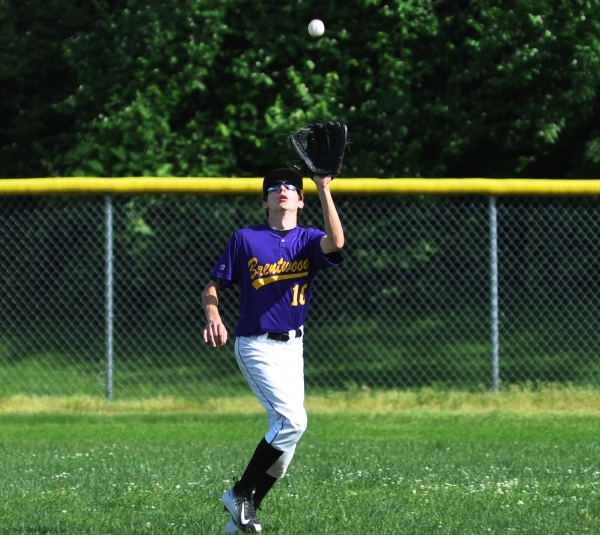 Center fielder Eddie Wright  catches a Valley Park fly ball in the first inning.
