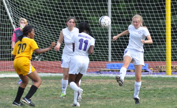Anna Blomstrom kicks the ball away from Brentwood's goal.