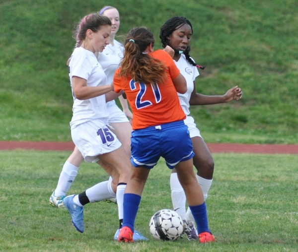 Smothering a Valley Park player are (from left) Aileen Frazier, Torri Brotherton and Cierra Lucas.