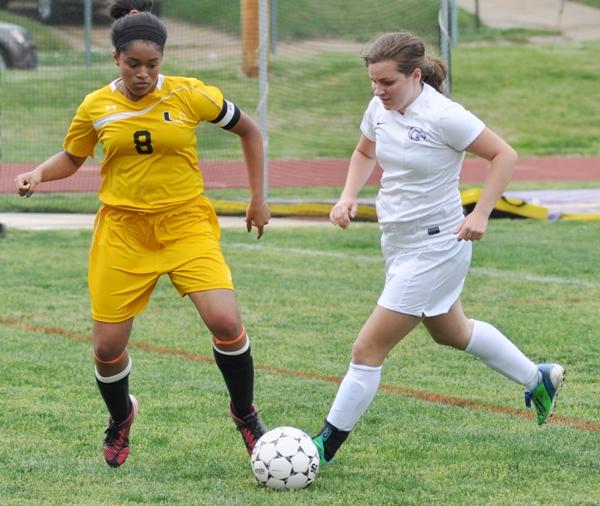 Emma Stoverink challenges a U City player.