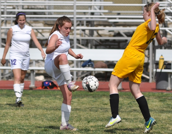 Abby Harper (left) tries to settle the ball.