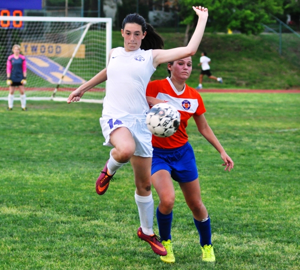 Amanda Ingersoll jumps to settle the ball in the first half.