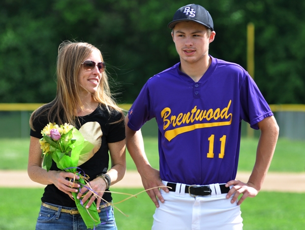 Before the Valley Park game, Bradley Jones is honored as Brentwood's only senior. He stands here with his mother.