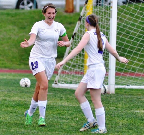 Tara Lochmoeller (left) celebrates her goal with Torri Brotherton.