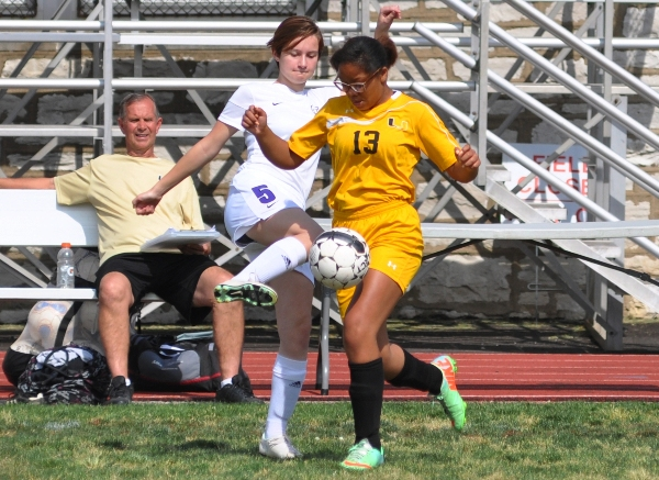 Kelsey Krimmel spars with a University City player.