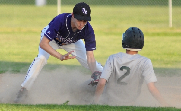 Chris Brown attempts to make a tag at second base.