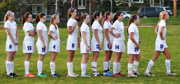 Brentwood players line up to slap hands with Crossroads after a Current win on April 28. They are (from left) Anna Blomstrom, Mickey Torres, Emma Stoverink, Julianna Nikodym, Natalie Featherston, Torri Brotherton, Madeline Neely, Aileen Frazier, Amanda Ingersoll, Abby Harper and Kate Gilmore. (All photos by Steve Bowman)