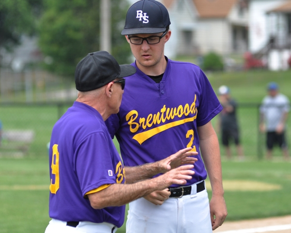 Assistant coach Elliott Sterett talks with Mike Imergoot in the seventh inning.